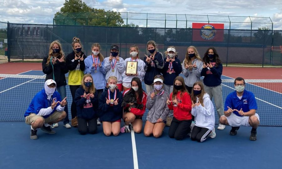 After winning the GAC North-Central Division championship, the girls tennis team show off their first place plaque and medals.