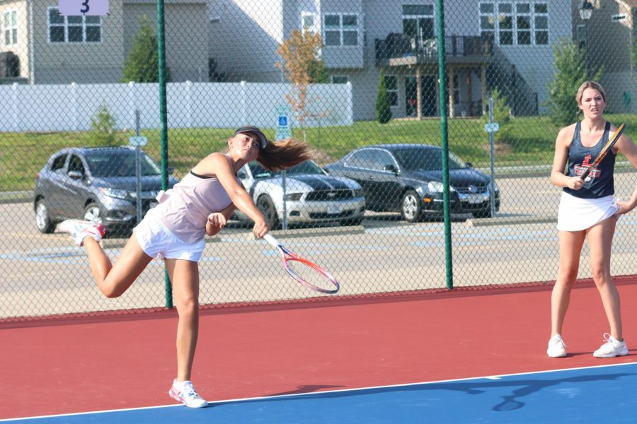 Freshman Isabella Gamm serves a shot at a practice earlier in the season.