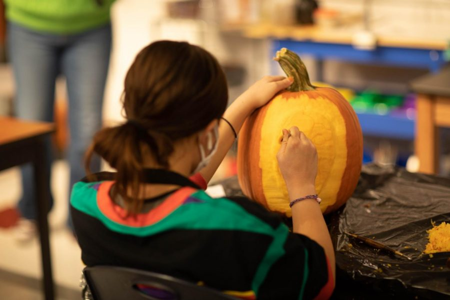 Brianna Reddick carves her pumpkin.