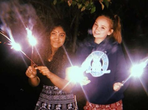 Arthi Kondapaneni (left) celebrates Diwali with her friend Caitlyn Conrad.