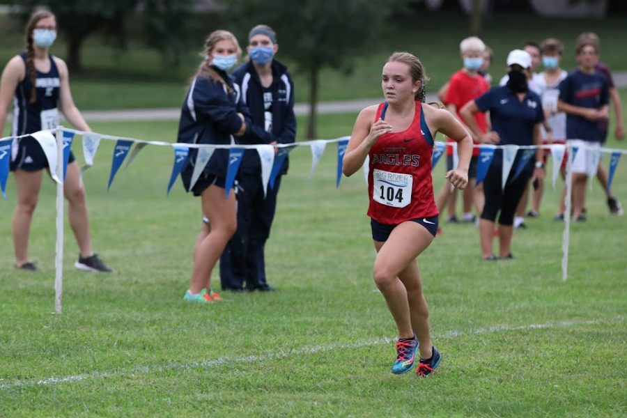 Ally Kruger races to the finish line at the Forest Park Invitational that took place this season on Sept. 12 at McNair Park.