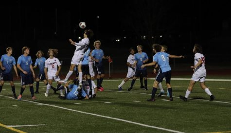 Multiple Liberty players battle it out with members from St. Dominic to gain possession of the ball in the district final.
