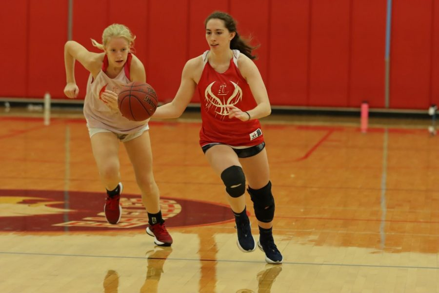 Sara Gordley (12) on a fast break being chased by Dori Earle (11) at an early season practice.