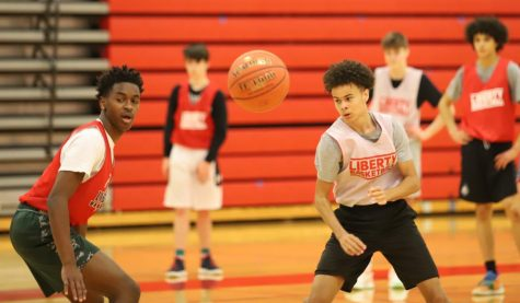 Jayden Betton and Connor Harris work on a drill in basketball practice on Tuesday, Nov. 17. Despite the district being at Level 3, after school activities such as winter sports are still taking place.