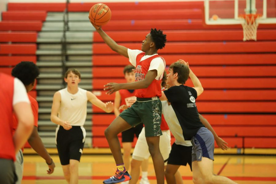 Jaden Benton(11) goes in for a layup in a scrimmage.