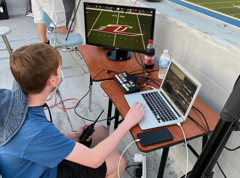 Jayce Haun (10) uses OBS (a live-streaming software) to prepare for the streaming of the football game.