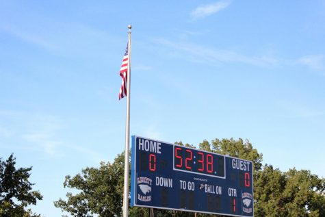 The United States flag out by the football field right before the game Timberland vs. Liberty.