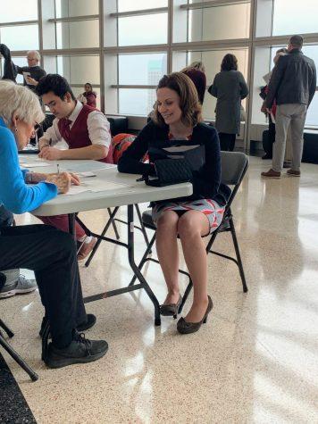 Mrs. Oliva registers to vote shortly after her naturalization ceremony.
