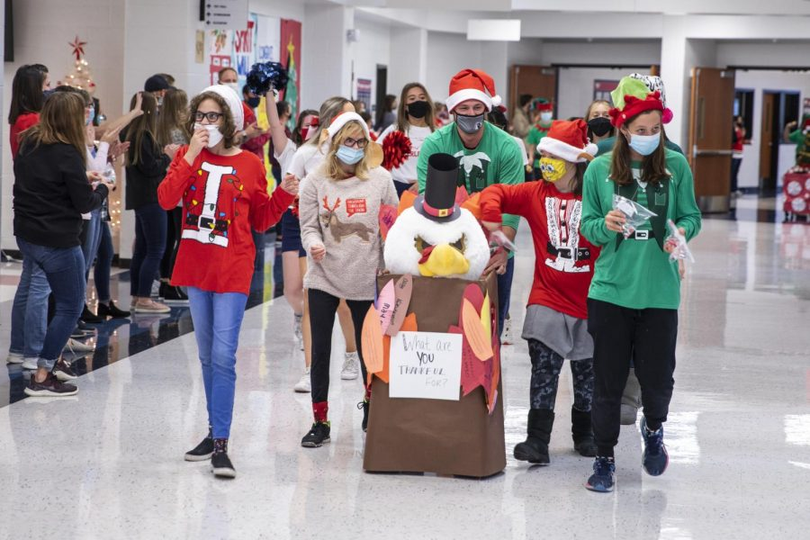 Students and staff participate in a Thanksgiving parade on the first floor Nov. 24.