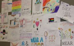 Activism club made political art in their first meeting and hung it in the cafeteria.