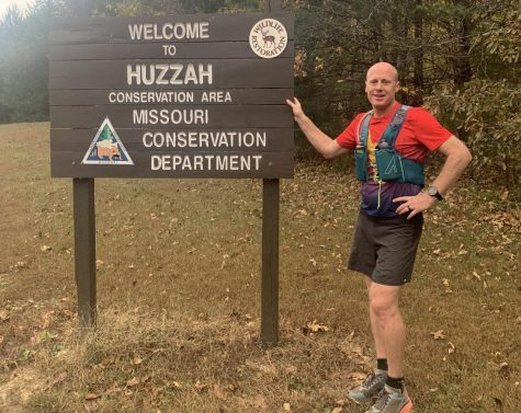Mr. Eldredge stands next to the Huzzah Conservation area sign, where he finished his race.