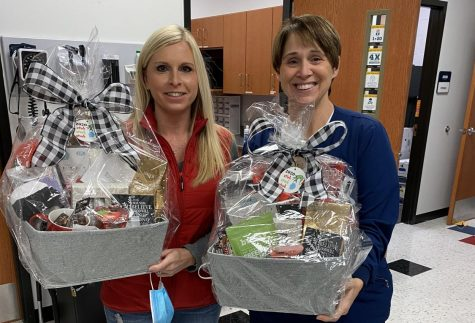 Marcey Watkins (right) and Bridget Thomason hold their baskets that the LHS staff presented to them, in appreciation of their work.
