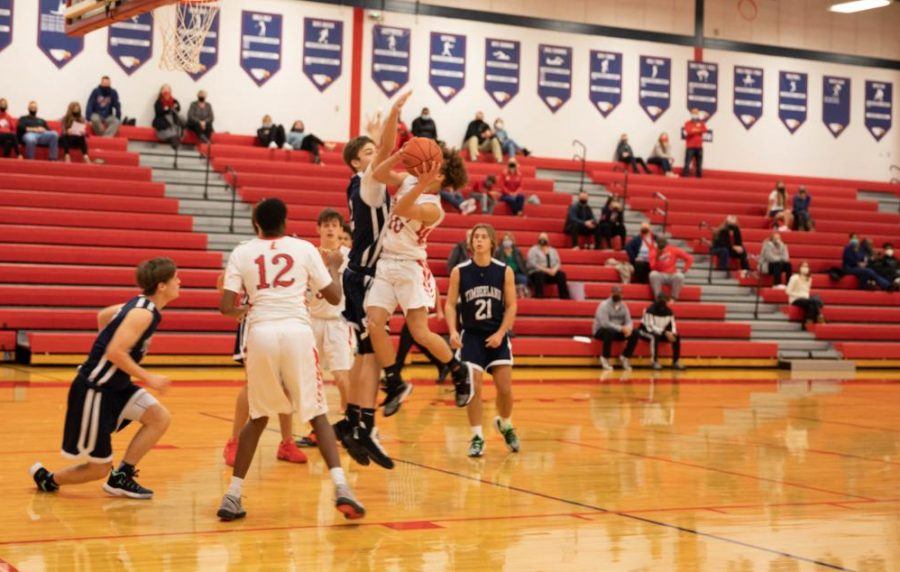 Sophomore Ashton Long drives to the basket while Blake Cunningham gets in position for the rebound.