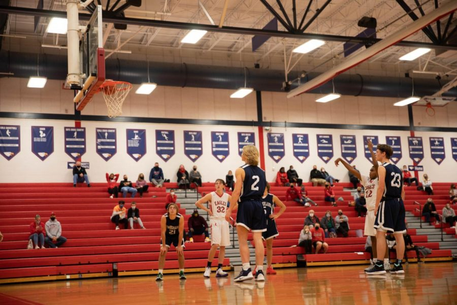 Blake Cunningham makes a free throw while Charlie Hebden looks on.