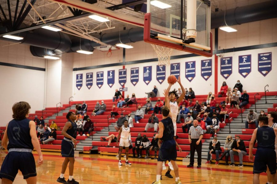 Adrian Lee pulls up for a jump shot over a Timberland player.