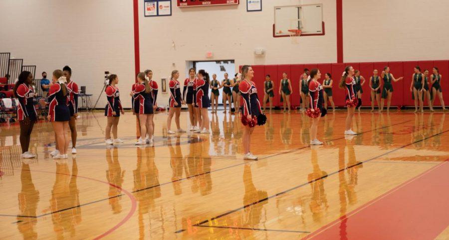 Varsity cheerleaders setup for their halftime performance.