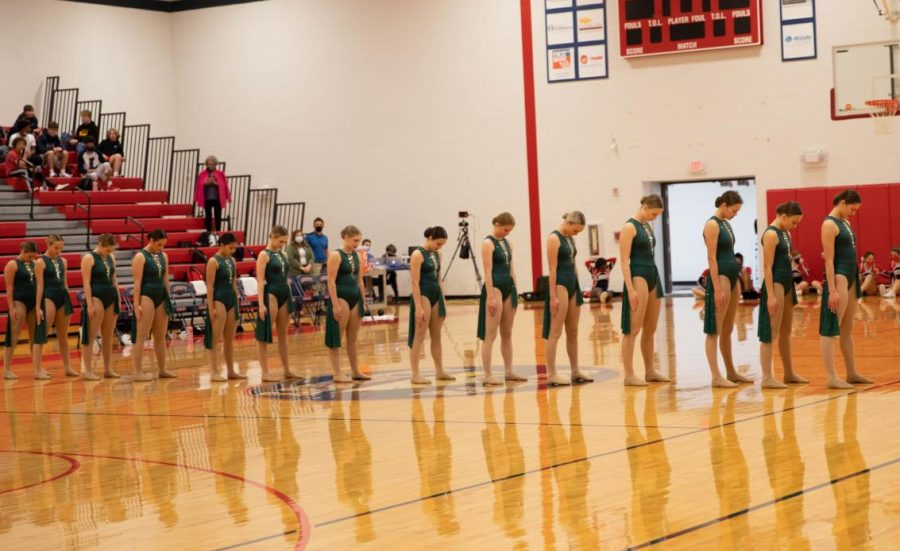 They varsity dance team gets ready to perform for halftime.