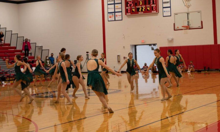 Varsity dance team performs at halftime.