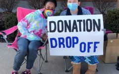 Volunteers Leilani Green (9) and Olivia Guffey (12) at the donation drop-off the outreach committee hosted