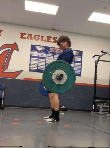 Clayton Barteau deadlifts in the Liberty Weight Training room.