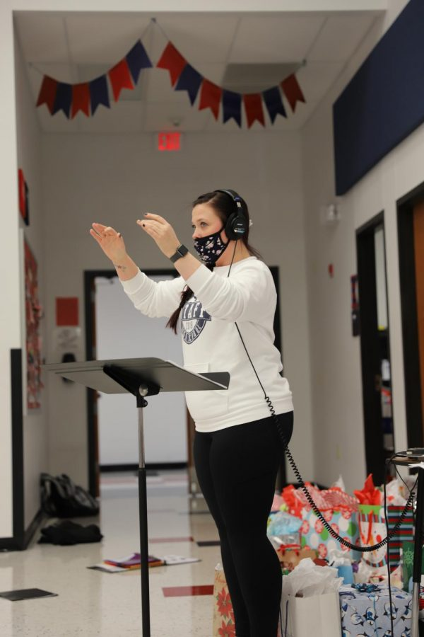 Ms. Kennedy conducts the choirs, as they gathered at Liberty on Dec. 14 to record the music they prepared over the course of the semester.