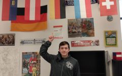 Jax Drezek points to a German flag in Mr. Stoll's room.