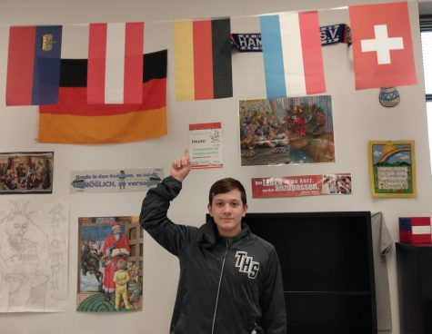 Jax Drezek points to a German flag in Mr. Stoll