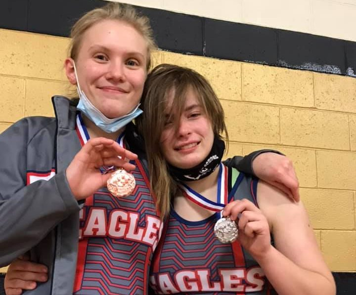 Lil Clay holds up her bronze, (Left), and Elektra Lowe holds up her silver, (Right), after the GACs tournament.