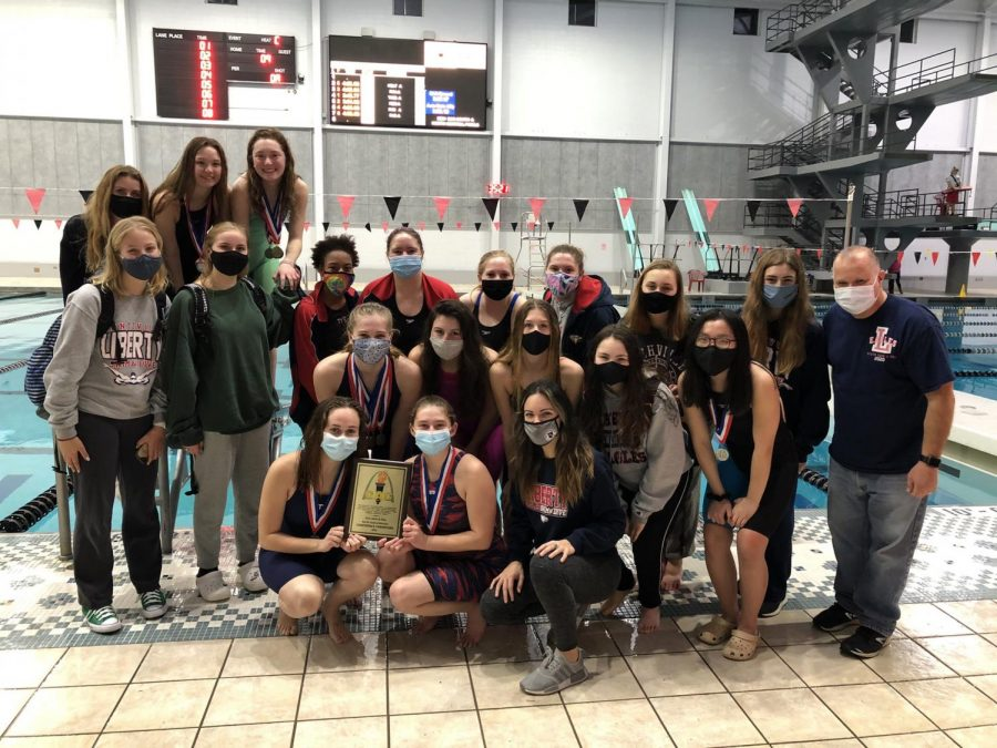 The+girls+swim+and+dive+team+celebrates+their+GAC+championship+on+Feb.+10+at+the+Rec-Plex.