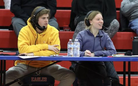 Tyler Metheney (11) and Katie Swanson (12) do live commentary at the girls basketball game.