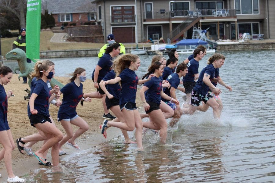 Students plunge into a freezing cold Lake St. Louis to raise money for the Special Olympics of Missouri.