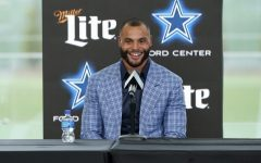 Dallas Cowboys quarterback Dak Prescott shows excitement during the press conference for his record breaking new deal.
