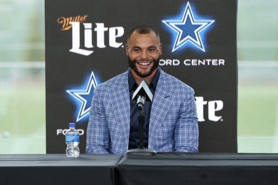 Dallas Cowboys quarterback Dak Prescott shows excitement during the press conference for his record breaking new deal.