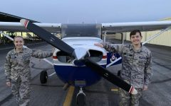 Jaxon Drezek and his partner Alexandria Hammack stand in front of the Cessna Skyhawk 172.