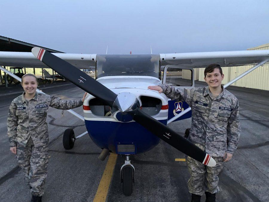 Jaxon Drezek and his partner Alexandria Hammack stand in front of the Cessna Skyhawk 172.