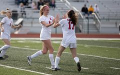 Maddie Lipp(6) celebrates a goal with Molly Link while Kyley Henry look on in a match against Fort Zumwalt West on March 22. The Eagles won 2-0.