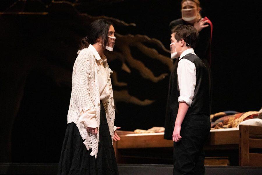 Tituba (Madeline Claravall) begs Reverend John Hale (Sean Bruce) to believe her innocence.