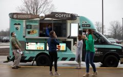 Staff members enjoy free coffees Wednesday thanks to the LHS administration.