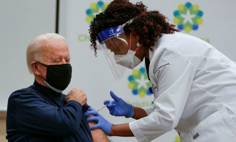 US President-elect Joe Biden receives a Covid-19 vaccination from Tabe Masa, Nurse Practitioner and Head of Employee Health Services, at the Christiana Care campus in Newark, Delaware on December 21, 2020.