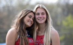 Bella Gamm (9) and Marley Nelson (9) pose for a picture at the track meet.