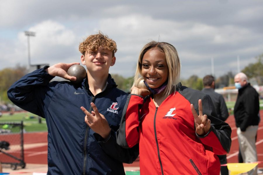 Zach Cash (9) and Toni Patterson (12) gets ready to throw shot put.