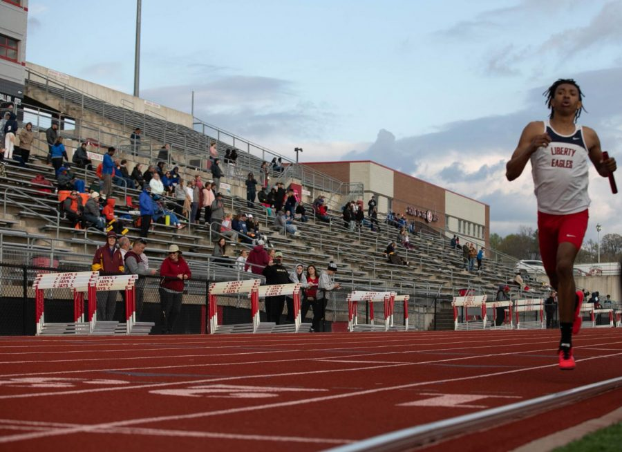 David Richard (11) finishes up the 4x400 relay race.
