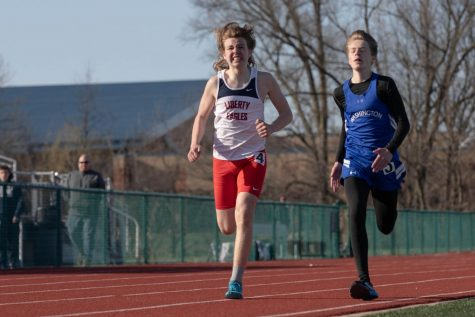 J.D. Grana pushes through the final stretch of his 1,600 meter race Thursday, April 1.