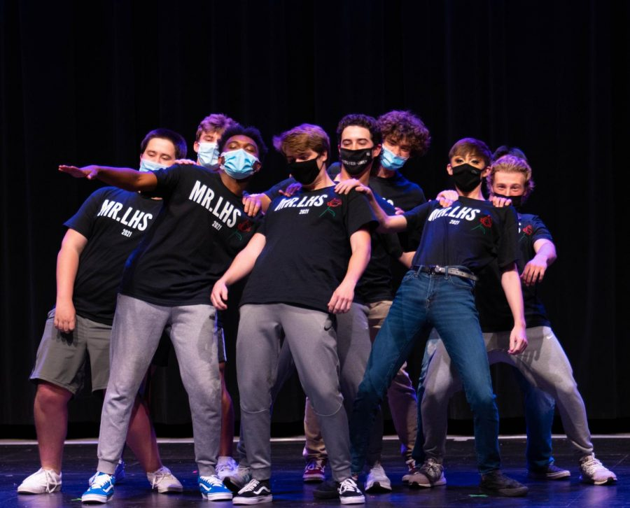 Mr. LHS contestants perform a group dance at the beginning of the show.