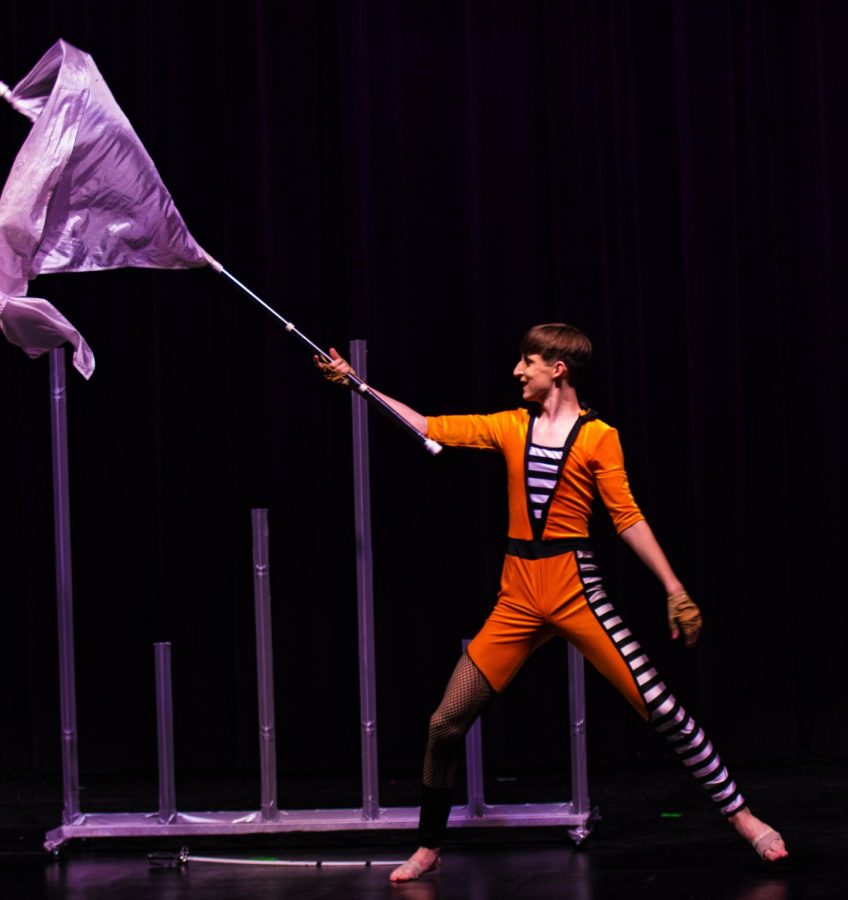 Eric Welker (12) performs a color guard routine to the Miley Cyrus song
