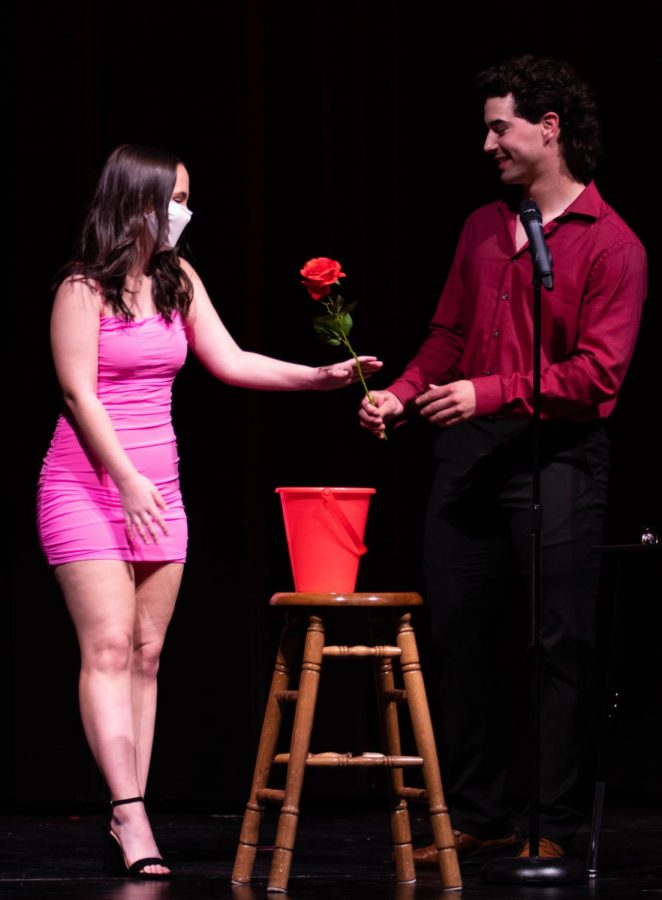 Victor Quinn (12) gives his date Emily Brockmann (12) a rose after saying his pick up line.