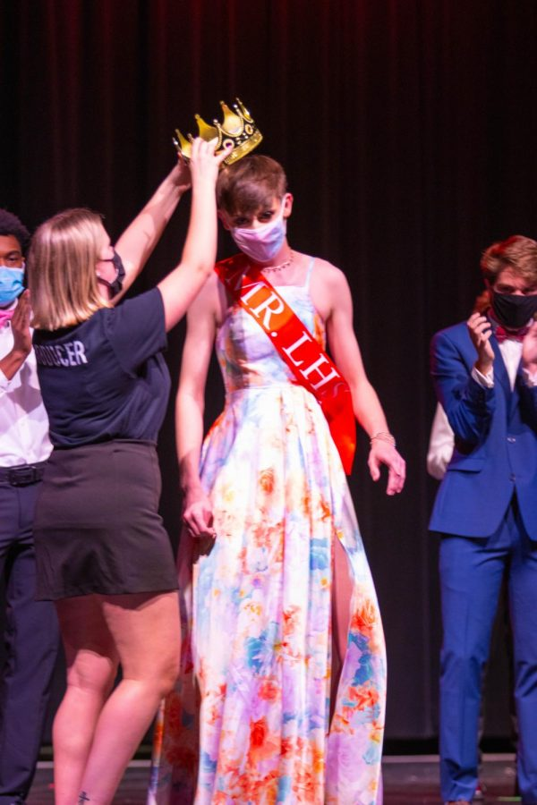 Eric Welker (12) is crowned Mr. LHS by producer Liv Coughran (12).