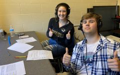 Tyler Metheney and Ally Schniepp broadcast a game's varsity soccer game from the press box. Metheney has broadcast both boys and girls basketball in the winter and girls soccer in the spring.