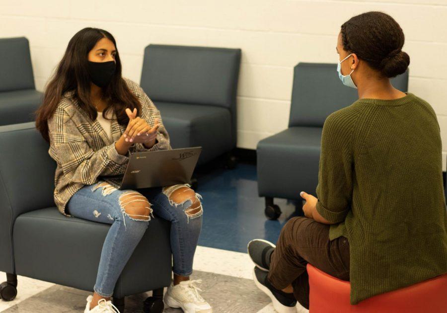 Sarvani Kunapareddy talks with Aiche Beye during the Women's Workshop on March 17.