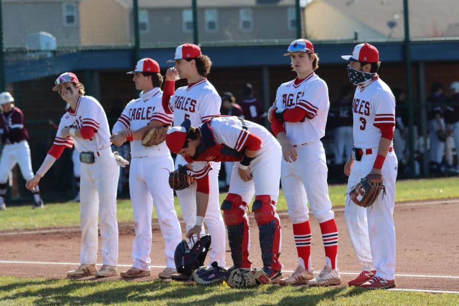 The Liberty baseball team prepares to play their home opener against Summit on march 19 The eagles won the game 10-4